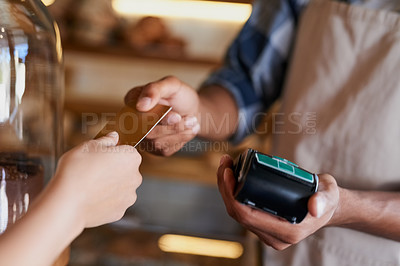 Buy stock photo Closeup shot of a customer making a credit card payment in a cafe