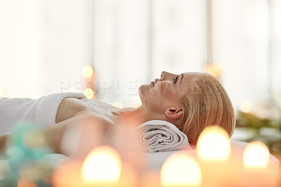 Buy stock photo Cropped shot of a young woman relaxing on a massage table at a spa