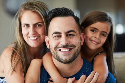 Buy stock photo Portrait of a happy family bonding together at home