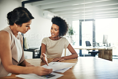 Buy stock photo Cropped shot of two colleagues having a discussion in an office