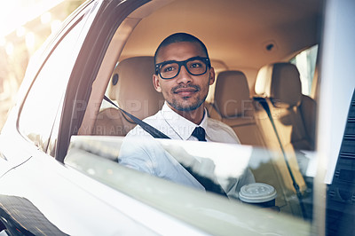 Buy stock photo Cropped shot of a businessman sitting in a car