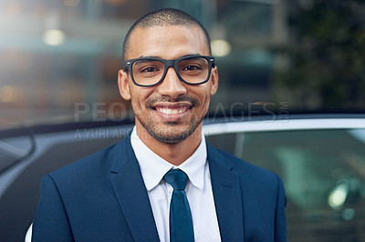 Buy stock photo Shot of a young businessman standing outside