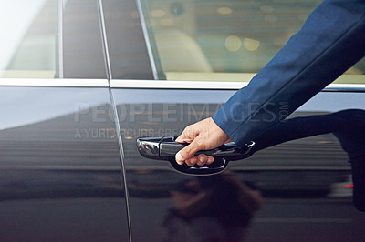 Buy stock photo Cropped shot of a well-dressed man opening a car door