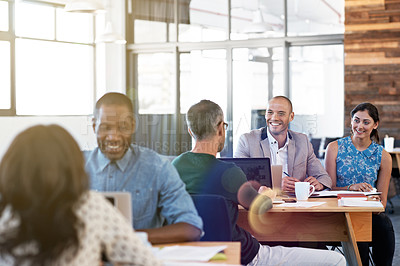 Buy stock photo Shot of a diverse group of professionals working together in a modern office