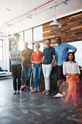 Buy stock photo Portrait of a diverse group of coworkers standing together in an office