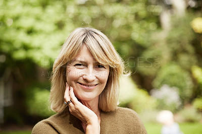 Buy stock photo Portrait of a mature woman standing outside in her yard