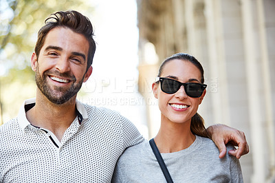 Buy stock photo Portrait of an affectionate young couple standing together in the city