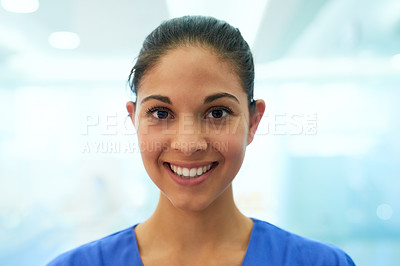 Buy stock photo Portrait of a confident young nurse smiling in the clinic