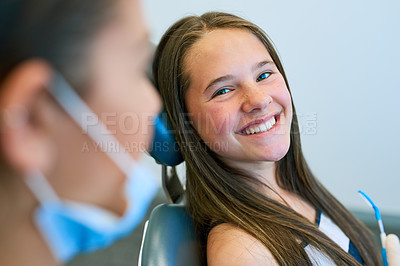 Buy stock photo Portrait of a young girl getting a checkup at the dentist