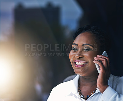 Buy stock photo Shot of a happy businesswoman answering her cellphone in the office