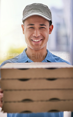 Buy stock photo Portrait of a happy deliveryman holding a stack of pizza boxes