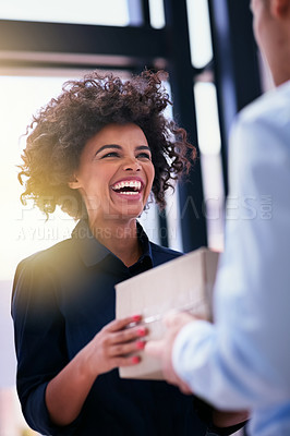 Buy stock photo Shot of a happy businesswoman accepting a package from an unidentifiable courier in the office