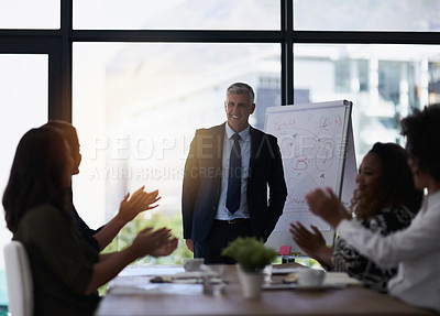 Buy stock photo Shot of a team of silhouetted businesspeople attending a meeting in the boardroom