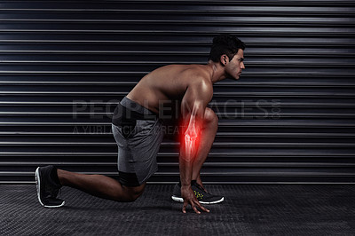 Buy stock photo Full length shot of an athletic young man on his mark before a run
