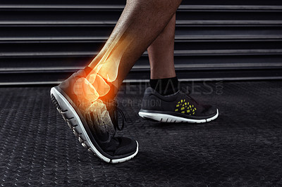 Buy stock photo Cropped shot of an unrecognizable man working out with an ankle injury