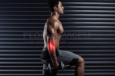 Buy stock photo Cropped shot of an athletic young man working out with dumbbells