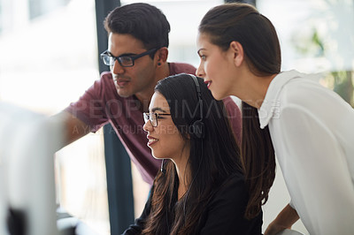 Buy stock photo Shot of colleagues working together in an office