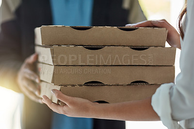 Buy stock photo Cropped shot of a man making a pizza delivery to a customer