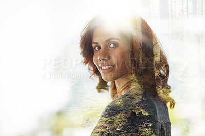 Buy stock photo Multiple exposure shot of young businesswoman superimposed over a forest landscape
