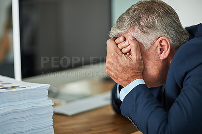 Buy stock photo Cropped shot of a mature businessman feeling stressed in the office