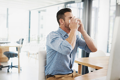 Buy stock photo Cropped shot of a young businessman suffering with allergies in an office