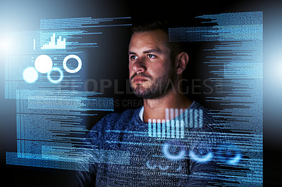 Buy stock photo Shot of a focussed computer programmer working at his computer late at night