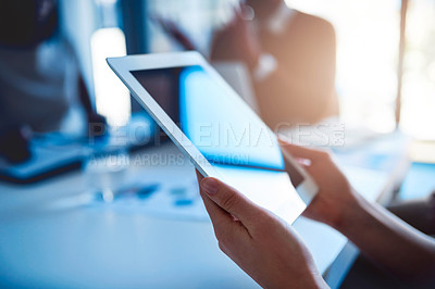 Buy stock photo Shot of an unidentifiable businesswoman holding a tablet during a meeting in the office