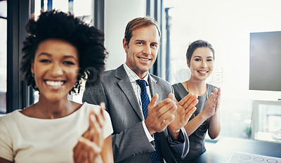 Buy stock photo Cropped shot of a group of businesspeople applauding a business presentation