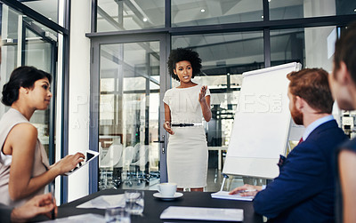 Buy stock photo Shot of a businesswoman doing a presentation in a boardroom