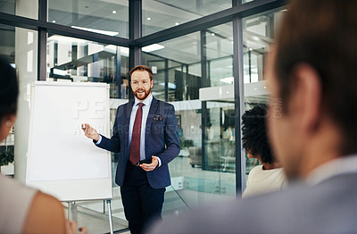 Buy stock photo Shot of a businessman doing a presentation in a boardroom