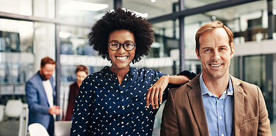 Buy stock photo Portrait of a confident businessman and businesswoman working together in a modern office