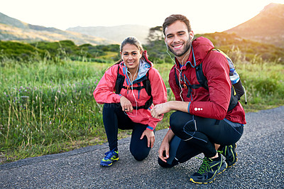 Buy stock photo Portrait of a two smiling friends out for a run together on a cool morning