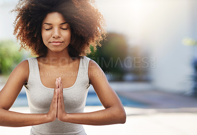 Buy stock photo Cropped shot of a sporty young woman practicing yoga outdoors