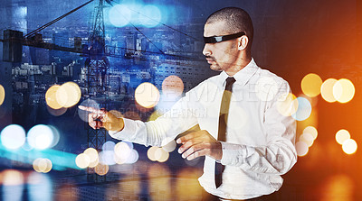 Buy stock photo Shot of a young businessman wearing a vr headset superimposed over a cityscape