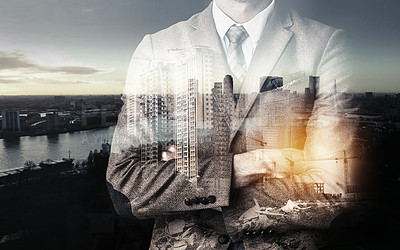 Buy stock photo Cropped shot of an unidentifiable businessman superimposed over a cityscape