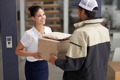 Buy stock photo Cropped shot of a courier making a delivery to a businesswoman at her office