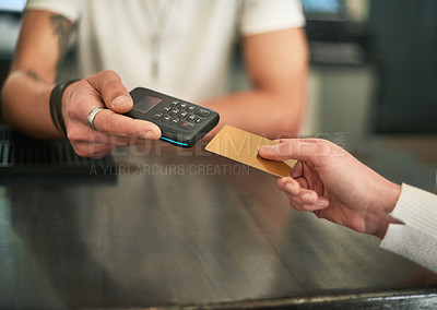 Buy stock photo Cropped shot of an unidentifiable woman making a card payment with a wireless payment device