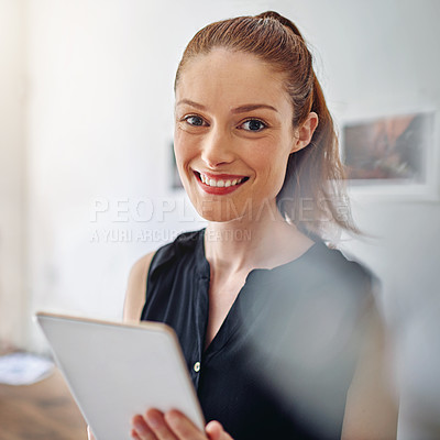 Buy stock photo Portrait of a young woman standing in an office using a digital tablet