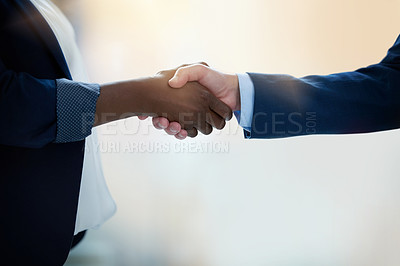 Buy stock photo Shot of two unrecognisable businesspeople shaking hands in an office