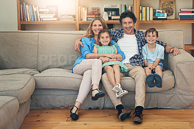 Buy stock photo Portrait of a happy family relaxing on the sofa together at home
