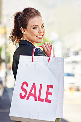 Buy stock photo Shot of a young woman out in the city on a shopping spree