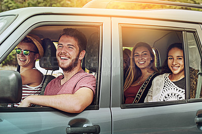 Buy stock photo Cropped shot of a group of friends enjoying a roadtrip together