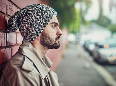 Buy stock photo Shot of a fashionable young man wearing urban wear in the city