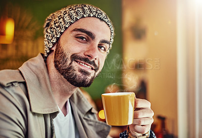 Buy stock photo Portrait of a stylish young man smiling while drinking a coffee in a cafe