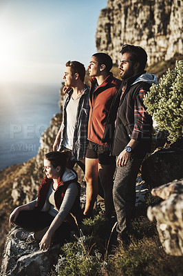 Buy stock photo Shot of a group of friends admiring the view while hiking in the mountains