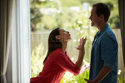 Buy stock photo Shot of a mature couple having relationship problems at home