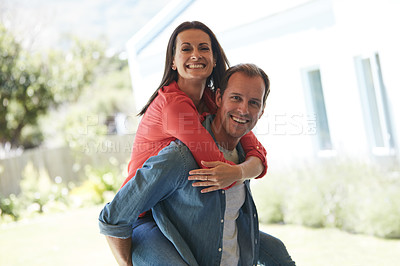 Buy stock photo Portrait of a mature couple enjoying the day outside together