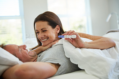 Buy stock photo Shot of a mature couple feeling excited after taking a home pregnancy test