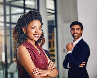 Buy stock photo Cropped shot of a young businesswoman looking thoughtful with her colleague in the background