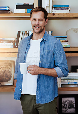Buy stock photo Cropped portrait of a handsome man drinking a coffee at home